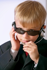 image of a young boy pretending to be a secret agent