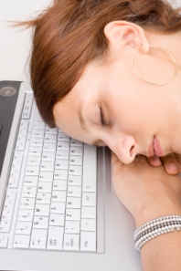 image of woman napping on keyboard